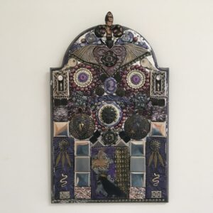 A mixed media mosaic featuring a central female face looking down on a raven and surrounded by various symbols.