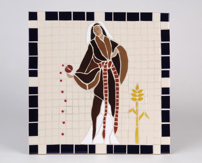 A square ceramic mosaic featuring a demure female figure in brown and white robes holding a pomegranate that is spilling 9 seeds onto the ground. There is a sheaf of corn on her other side.