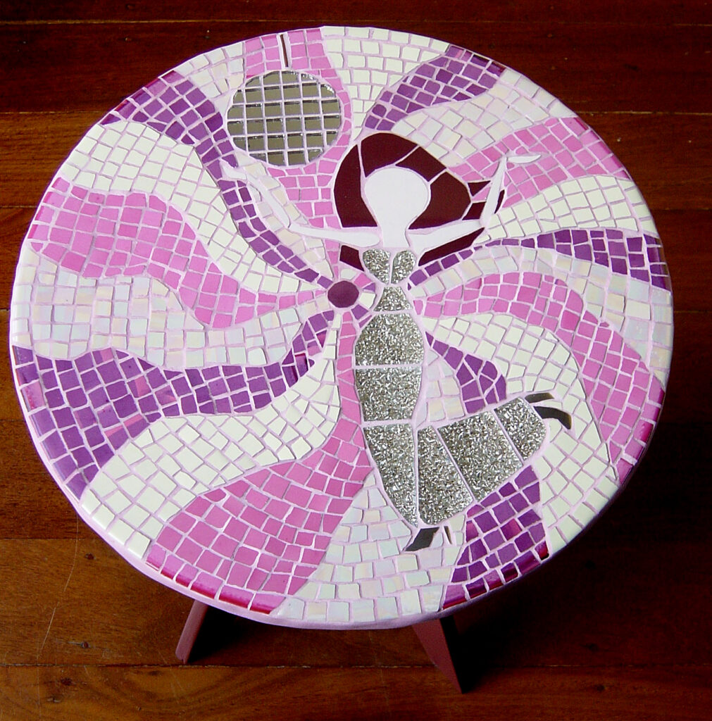 A fanciful side table with a dancing disco chick