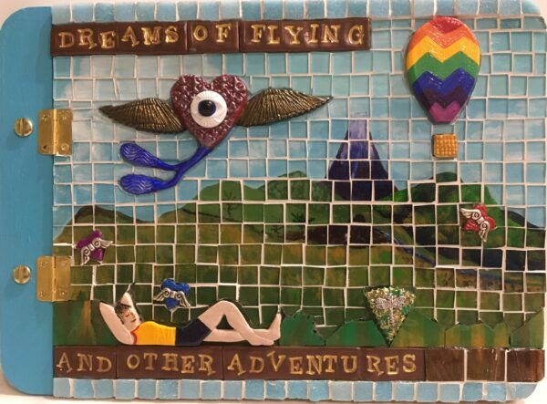 Image of a mosaic book cover featuring glass, polymer clay pieces and found objects.