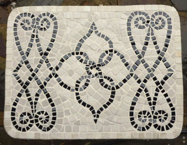 Image of a small black and white mosaic table top in marble and ceramic.