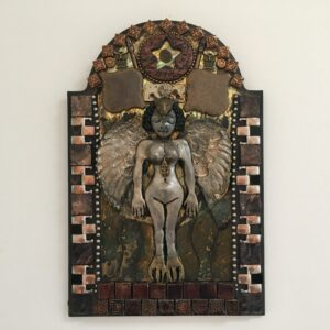 A mixed media mosaic featuring a central nude female figure with bronze coloured wings and bird claws for feet.