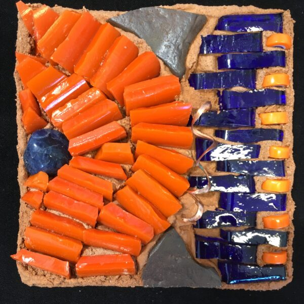 Image of a small abstract mosaic with orange and blue glass and other materials