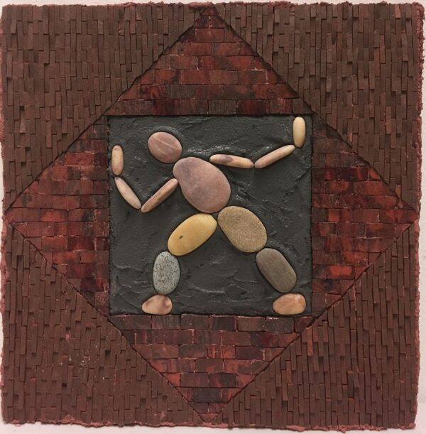 A square mosaic in dark reds featuring a pebble figure in the centre on a black square background.
