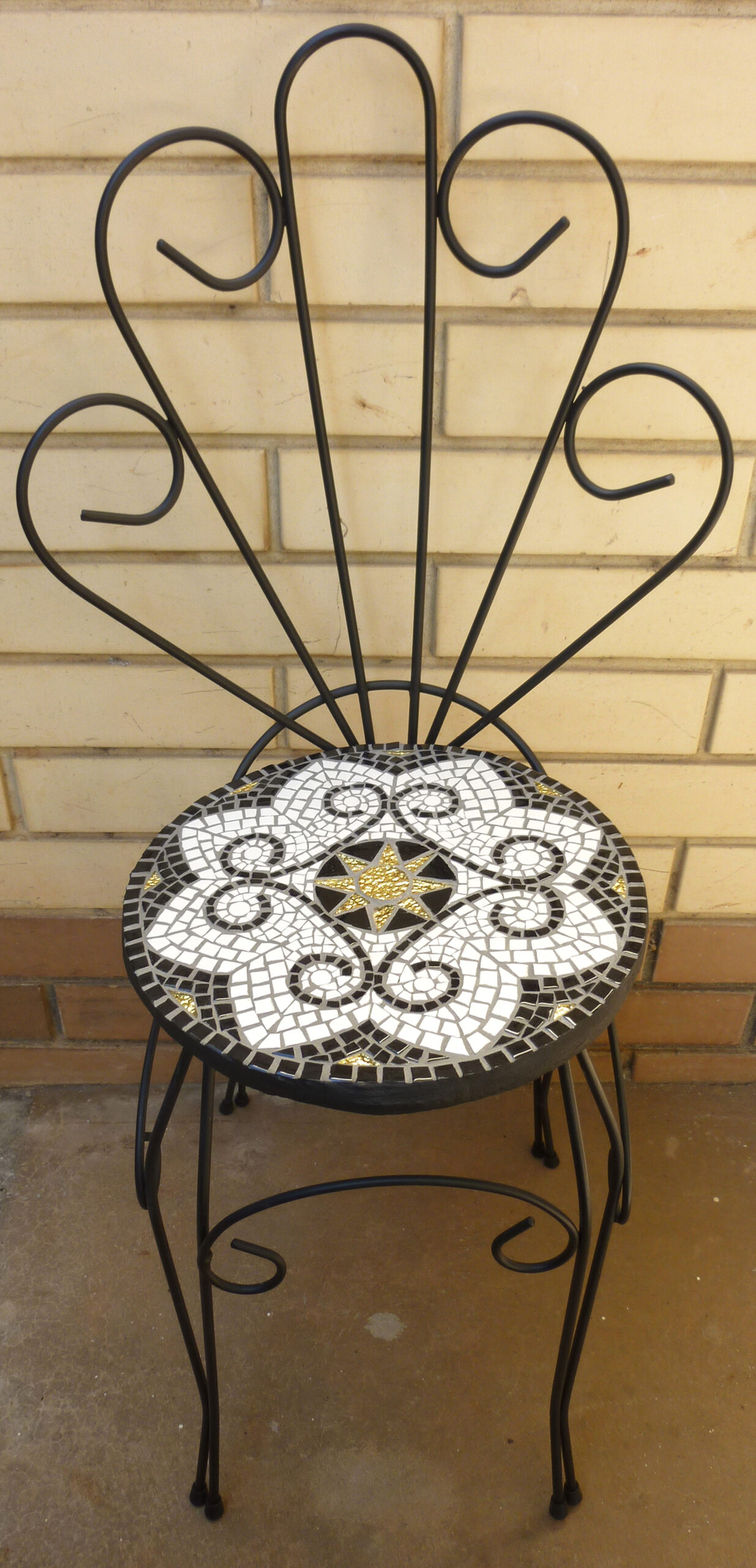 An upcycled wire chair that received a makeover in black & white and a touch of gold