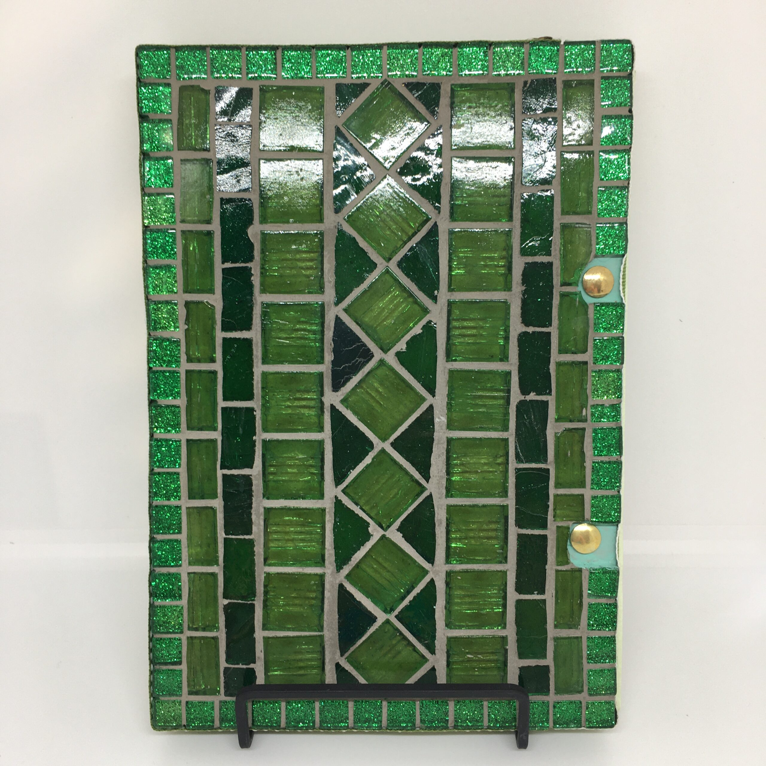 Back cover of Daffodil Days art journal featuring mosaic in green glass.