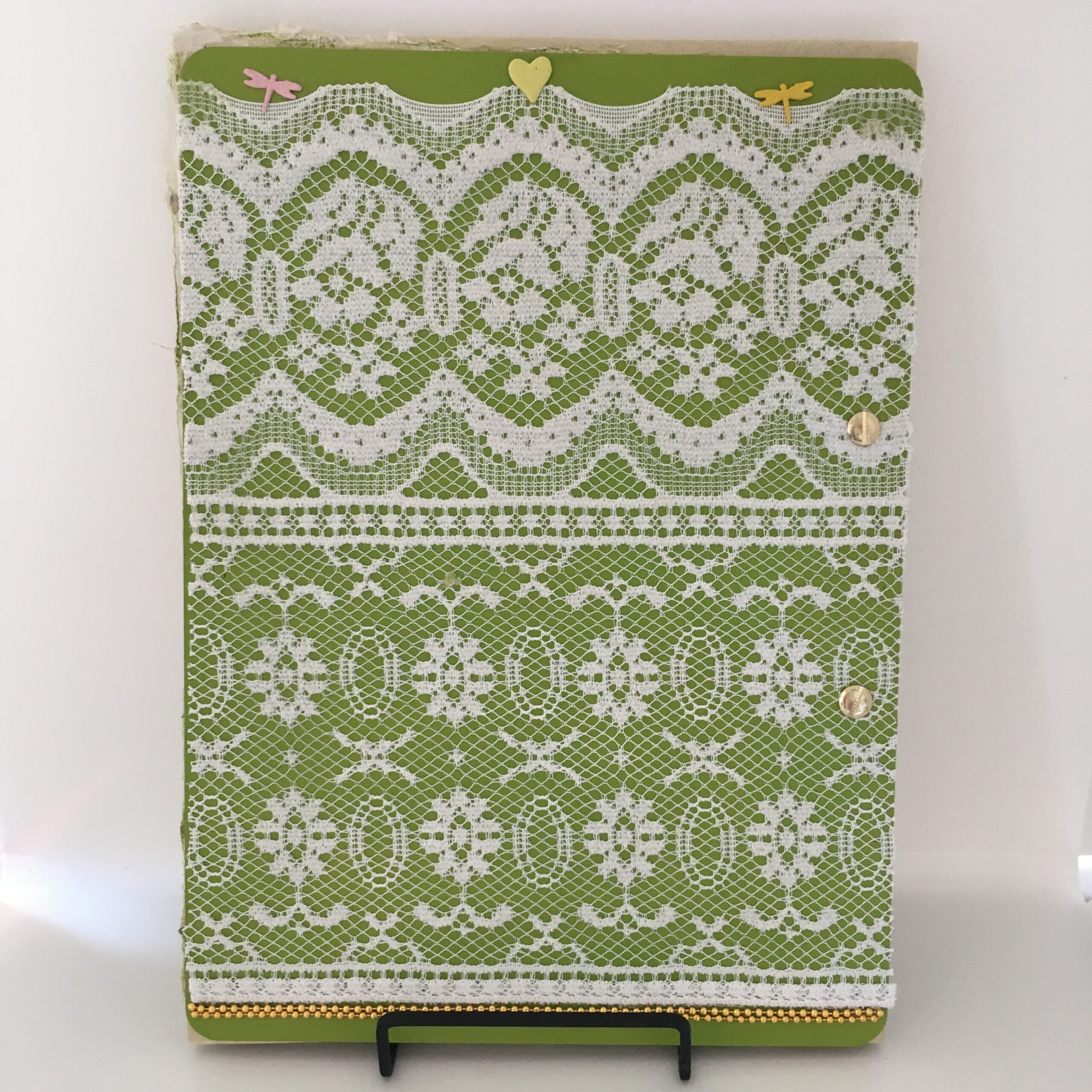 Back view of Spring Flings art journal, featuring lace fabric, gold beading and metal embellishments.